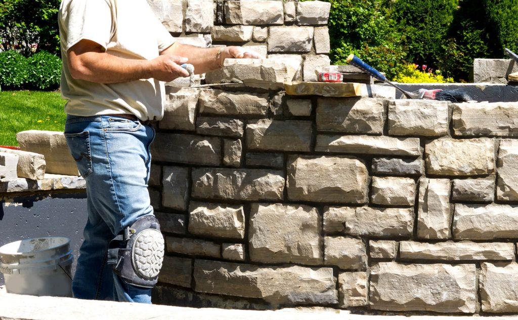 man-building-stone-firepit