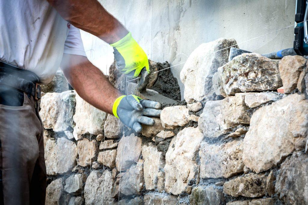man-laying-stone-wall