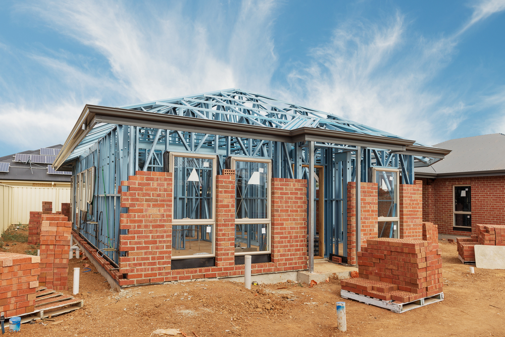 New,Residential,Construction,Home,From,Brick,With,Metal,Framing,Against